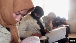 Afghan girls take a university admission test in Kunduz. Women now make up 30 percent of university students in Afghanistan