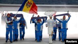 """Hey, I know that tune...sort of."" The Moldovan national team enters Fisht Stadium for the opening ceremony of the 2014 Sochi Winter Olympics on February 7."