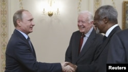 Russian President Vladimir Putin (left) meets with former U.S. President Jimmy Carter (center), former UN Secretary-General Kofi Annan, and other members of the Elders group at the Novo-Ogaryovo state residence outside Moscow on April 29.