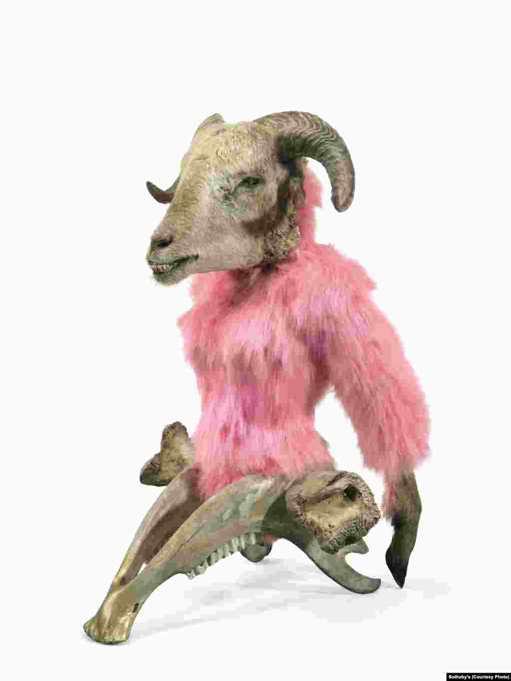 """""""Glamour Genetics,"""" a 2012 piece by Azerbaijani artist Mahmud Rustamov (b. 1967). The work incorporates a sheep's head, goat feet, a cow's lower jaw and thigh bone, and synthetic fur."""