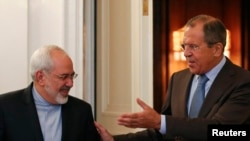 Russian Foreign Minister Sergei Lavrov (right) shows the way to Iranian counterpart Javad Zarif during a meeting in Moscow in August 2014.