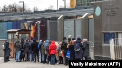 People wait in line to get their visas at the U.S. Embassy in Moscow.