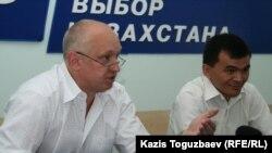 Algha leader Vladimir Kozlov with Communist leader Qadyr Qoshqarov hold a press conference in Almaty.