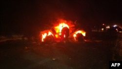 A vehicle burns near the Kerem Shalom border crossing after gunmen crossed into Israel from Egypt on August 5.