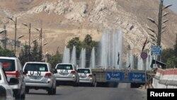 Սիրիա - ՄԱԿ-ի փորձագետների ավտոշարասյունը ուղևորվում է դեպի Դամասկոսի զինվորական հոսպիտալ, 30-ը օգոստոսի, 2013թ․