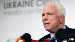 U.S. Senator John McCain speaks at a press conference in Kyiv during a previous visit in September 2014.