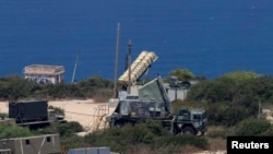 An anti-missile battery is deployed in the northern city of Haifa (file photo)