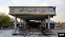 A picture taken on November 17, 2019 shows a scorched gas station that was set ablaze by protesters during a demonstration against a rise in gasoline prices in Eslamshahr, near the Iranian capital of Tehran.
