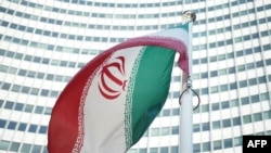 An Iranian flag waves in a wind outside the Vienna International Centre hosting the United Nations (UN) headquarters and the International Atomic Energy Agency (IAEA)