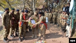 FILE: Pakistani Army soldiers attend a funeral ceremony of their comrade killed during clashes across the Line of Control, the de facto border between Pakistani and Indian administered parts of Kashmir, during his funeral in November 2016.