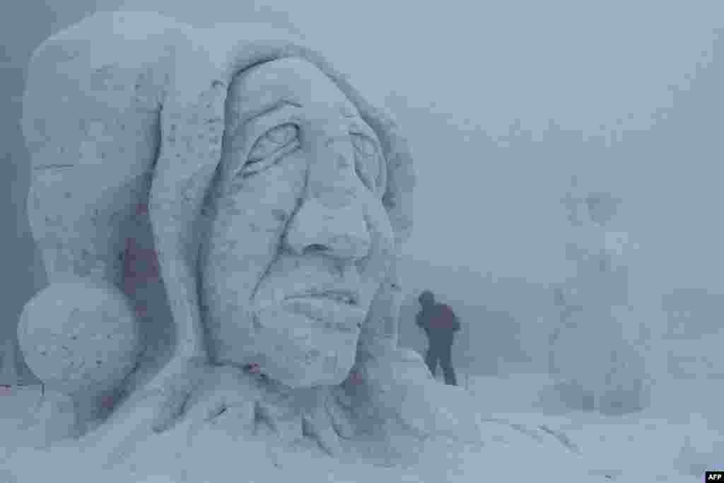 """A snow sculpture is pictured during the 15th International Sculpture Symposium """"Snow Kingdom 2013"""" in Pustevny, Czech Republic. The event attracts more than 30 artists and is attended by around 10,000 visitors. (AFP/Radek Mica)"""