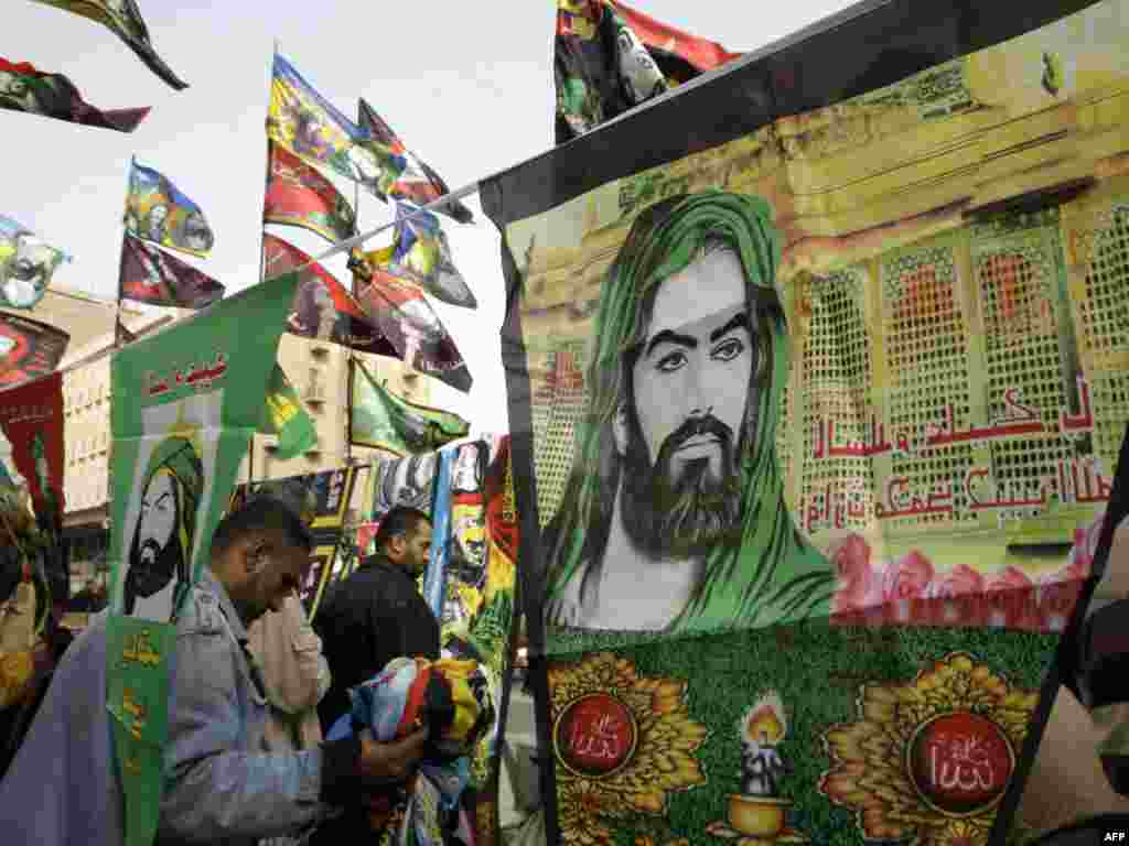 Imam Hussein's image is omnipresent at the height of Ashura and throughout the 40 days of mourning that follows. Here, street vendors in downtown Baghdad are selling pennants and other items portraying Hussein, who felt the Umayyad caliphate threatened the imposition of hereditary leadership.