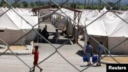 Один из лагерей сирийских беженцев в Турции