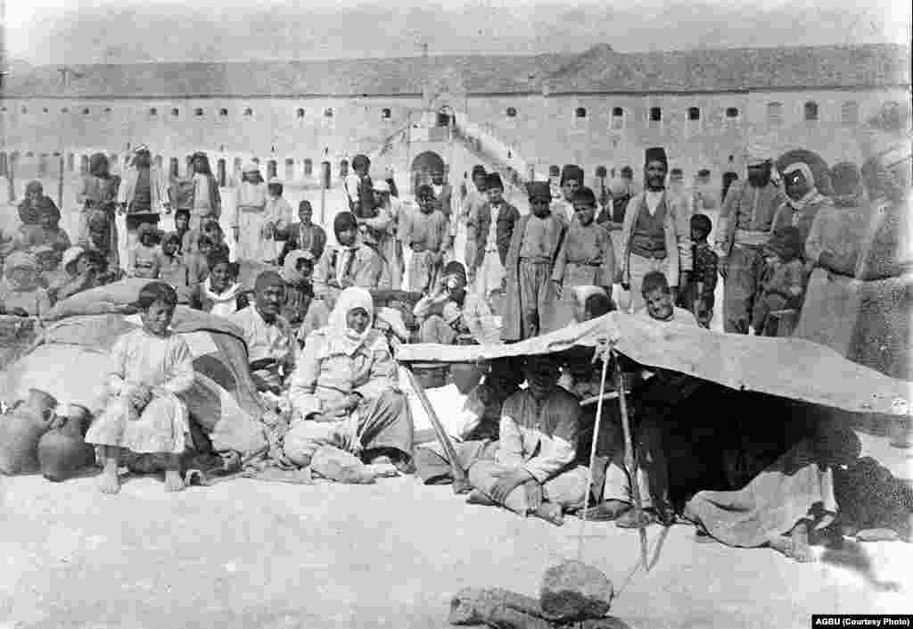 The courtyard of Aleppo's Ottoman barracks, converted into a reception center for Armenians fleeing the mass killings that took place in Armenia during WWI (probably late 1918)