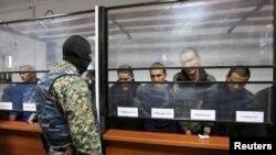 Të akuzuarit në një gjykatë në qytetin Aqtobe në Kazakistan
