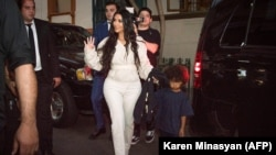 American reality TV star Kim Kardashian walks with her son Saint in Yerevan on the evening of October 7.