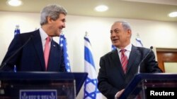 U.S. Secretary of State John Kerry (left) and Israeli Prime Minister Benjamin Netanyahu address a joint news conference in Jerusalem on December 5.