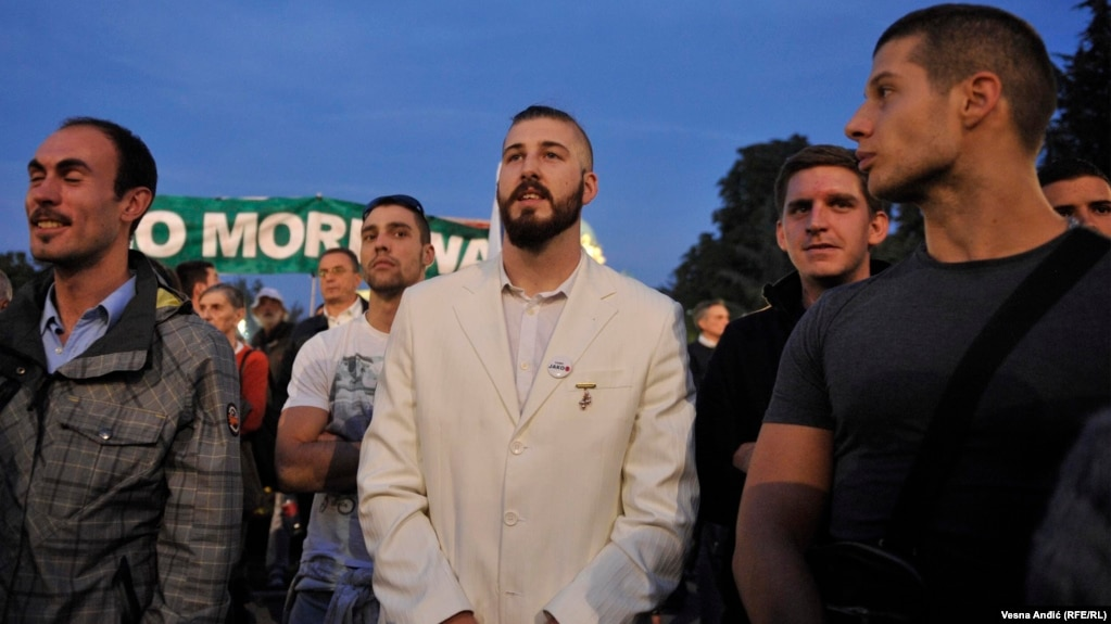 Maksimovic, wearing his trademark white suit, at a September 2016 protest against a controversial development project in Belgrade.