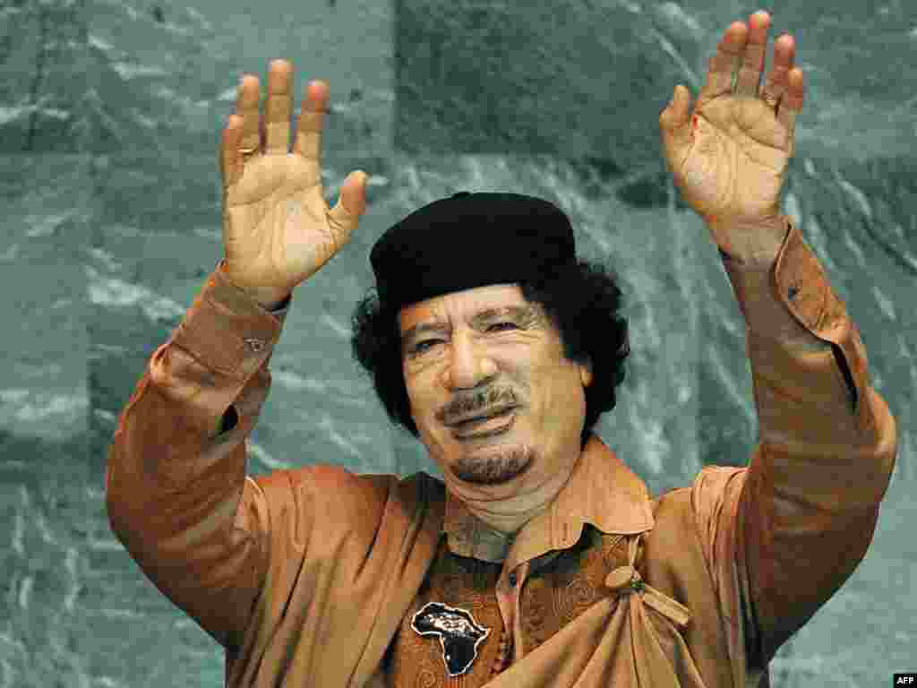 Qaddafi waves before delivering a long, rambling speech to the United Nations General Assembly on September 23, 2009 at UN headquarters in New York. It was his first speech to the General Assembly in his four-decade rule.