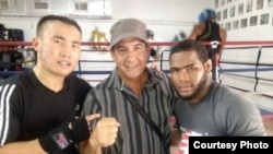 Qanat Islam (left), his manager Nelson Lopez (center), and Olympic gold medalist Felix Diaz in Miami