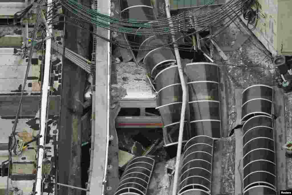 A New Jersey Transit train is seen under a collapsed roof after it derailed and crashed into the station in Hoboken, New Jersey. One person was killed and 100 others injured. (Reuters/Carlo Allegri)