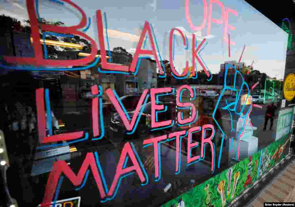 """Black Lives Matter"" is written in a shop window in the Dorchester neighborhood of Boston, Massachusetts, U.S., June 18, 2020."