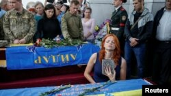 Can the EU ease sanctions while hostilities continue in eastern Ukraine?