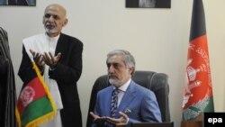Afghan President Ashraf Ghani (L) and Abdullah Abdullah.
