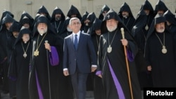 Armenia - President Serzh Sarkisian (C), Catholicos Garegin II (R) and Catholicos Aram I (L) and other clerics after the opening session of the Bishops' Synod in Echmiadzin, 24Sep2013.