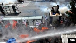 Turkish riot police use water cannon during the October 6 protests.