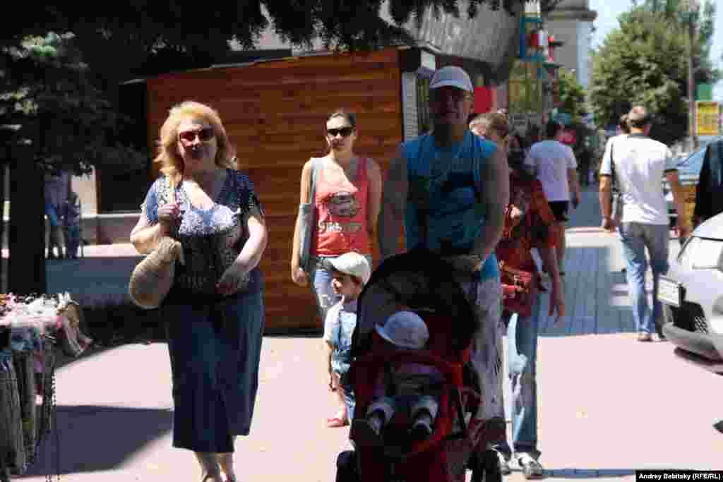 Families stroll in Luhansk.