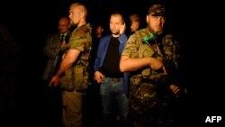 Александр Бородай, гражданин России, в то время один из главарей группировки «ДНР», которая в Украине признана террористической. Оккупированный Донецк, 17 июля 2014 года