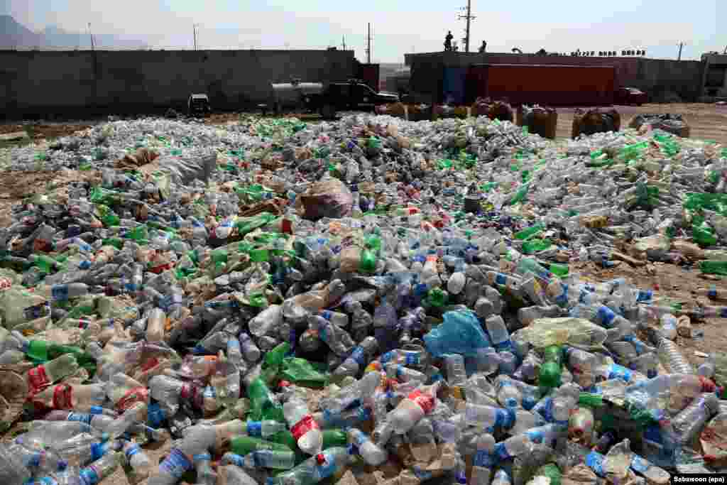 Discarded plastic bottles are collected and recycled into artificial fiber.