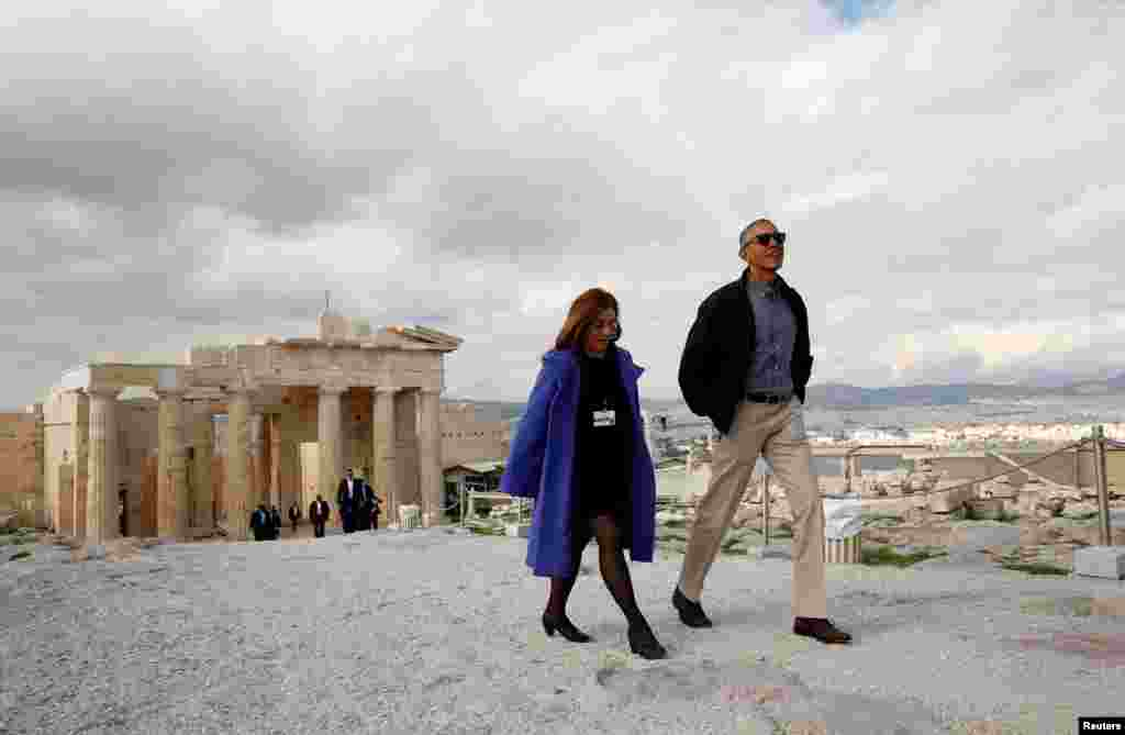 U.S. President Barack Obama tours the Acropolis in Athens with Eleni Banou from Greece's Ministry of Culture. (Reuters/Kevin Lamarque)