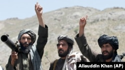 AFGHANISTAN -- Taliban fighters react to a speech by their senior leader in the Shindand district of Herat province, May 27, 2016