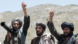 Taliban fighters react to a speech by their senior leader in the Shindand district of Herat Province in May 2016.