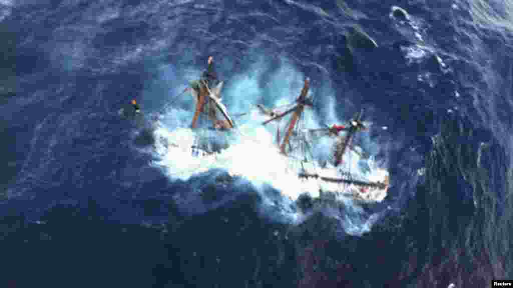"The ""HMS Bounty,"" a replica of an 18th-century sailing vessel, is shown submerged in the Atlantic Ocean southeast of Hatteras, North Carolina. At least one crew member died and another, the captain, is still missing."