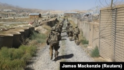 U.S. military advisers from the 1st Security Force Assistance Brigade walk at an Afghan National Army base in Maidan Wardak Province in 2018. (file photo)