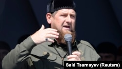 Chechen leader Ramzan Kadyrov delivers a speech during a rally in Grozny in support of Burma's Rohingya Muslim minority on September 4.
