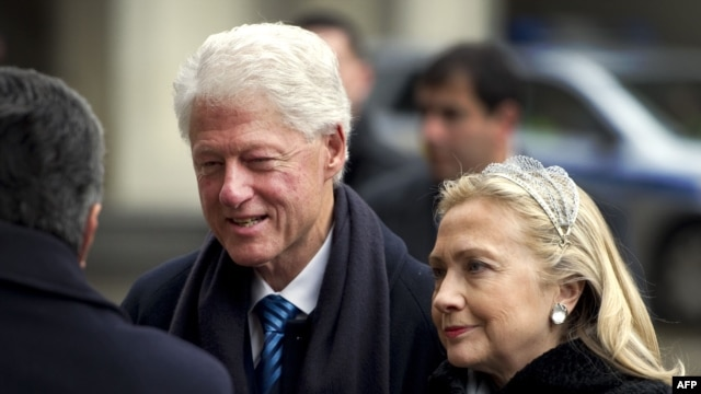 Former U.S. President Bill Clinton (left) and U.S. Secretary of State Hillary Clinton arrive for Vaclav Havel's funeral service in Prague.