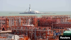 An oil rig (rear) and infrastructure of D Island, the main processing hub, are pictured at the Qashaghan offshore oil field in the Caspian Sea.