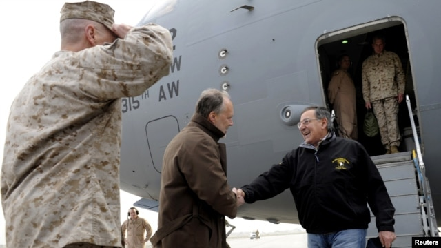 U.S. Defense Secretary Leon Panetta (right) is greeted by U.S. Ambassador to Afghanistan James Cunningham upon Panetta's arrival at Kabul International Airport on December 12.
