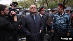 Armenia - Nerses Nazarian (C), chief of the Yerevan police, oversees riot police forces clashing with opposition protesters in Yerevan, 9Apr2013.
