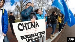 Uyghur activists protest against the visit of Chinese President Hu Jintao outside the White House in Washington, D.C., in 2011.