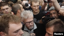 Opposition leader Eduard Limonov (in glasses) attends a protest rally to defend Article 31 of the Russian Constitution, which guarantees the right of assembly, in Moscow on July 31.