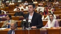 PAKISTAN -- Pakistani State Minister for Revenue Muhammad Hammad Azhar presents the federal budget for the fiscal year 2019-20.