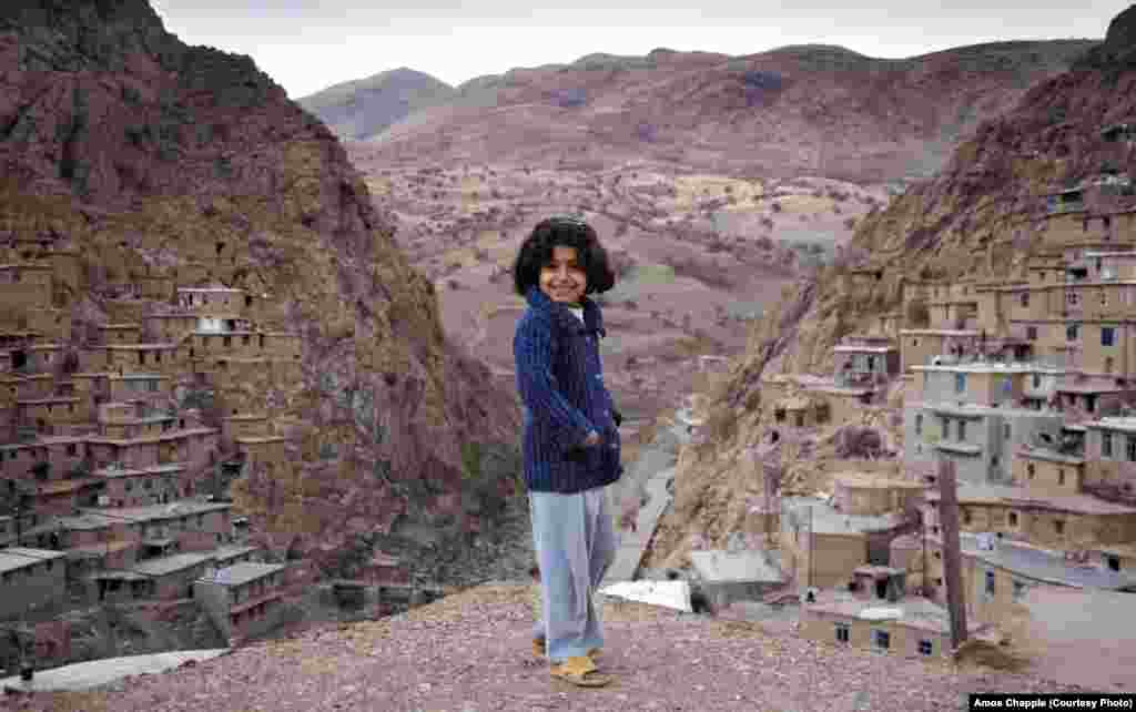 A Kurdish girl in Palangan village. The valley is so steep here that the roofs of many house serve as the yards of the houses above.
