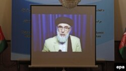A screen shows the broadcast of Gulbuddin Hekmatyar during a signing ceremony with Afghan government at the presidential palace in Kabul on September 29.