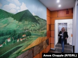 A woman walks in a corridor of the Hotel Pyramid of the Sun -- one of several pyramid-themed businesses in Visoko.