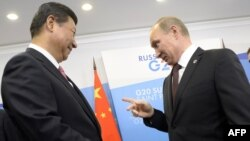 Си Цзиньпин и Владимир Путин, Санкт-Петербург, 5 сентября 2013 года.